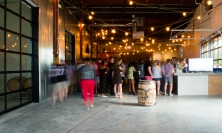 Customers bustle through the newly opened Monday Night Garage tasting room. CONTRIBUTED BY HENRI HOLLIS