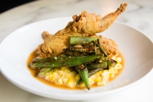 Crispy fried quail with creamed corn and okra gets a kick from the Middle Eastern spice mixture za'atar. CONTRIBUTED BY HENRI HOLLIS