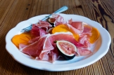 A starter of prosciutto with figs and persimmon. CONTRIBUTED BY HENRI HOLLIS